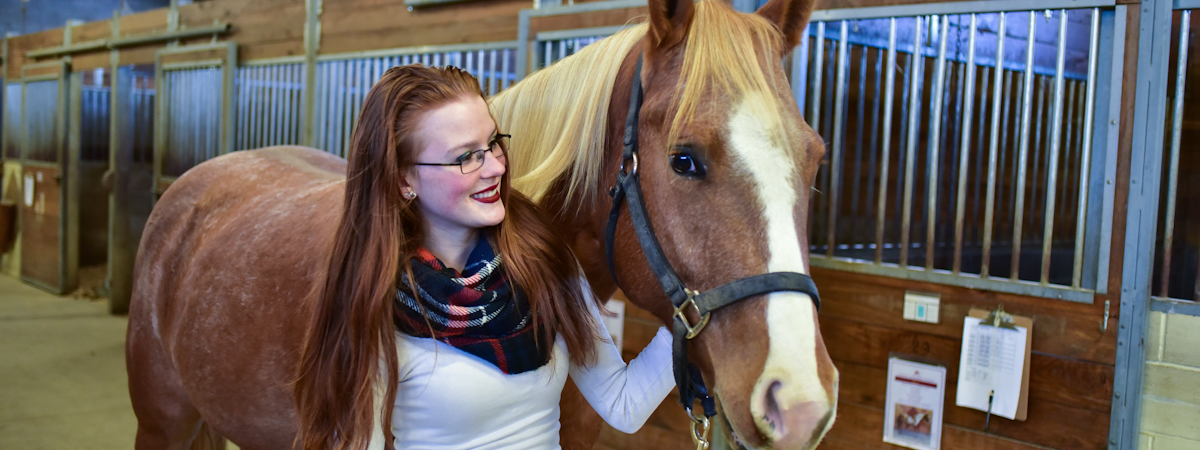 A student with a horse