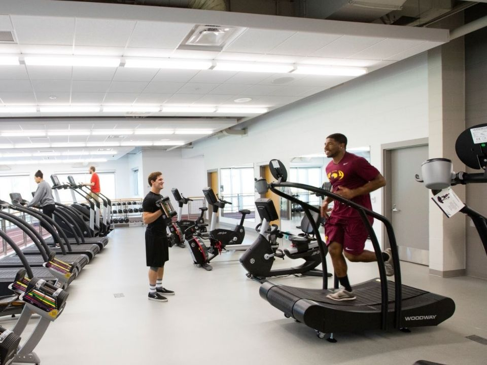 students on exercise equipment