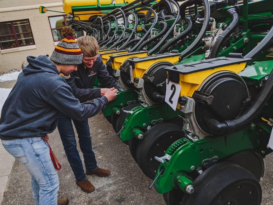 students working on tractor
