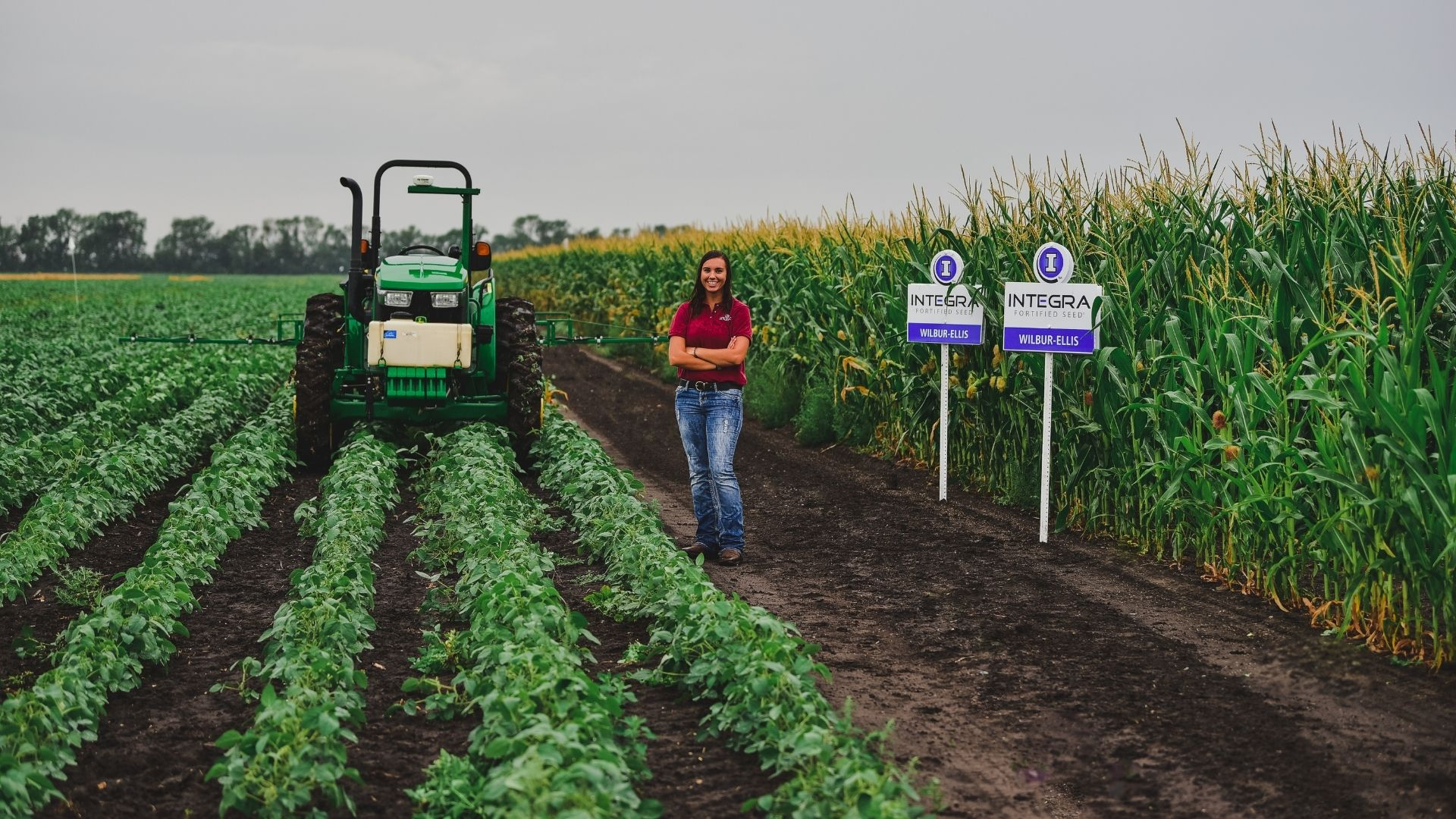 student standing in corn field