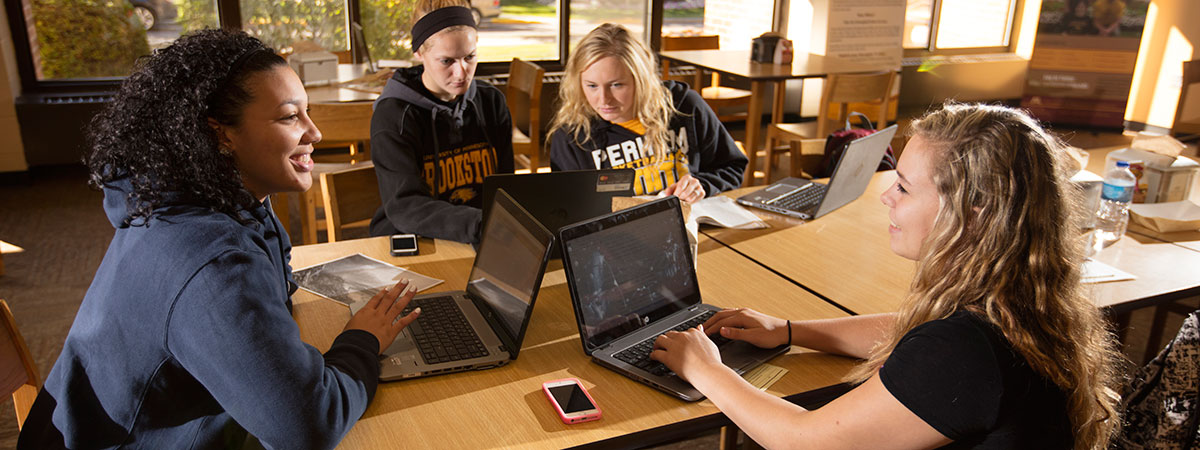 UMC female students hanging out in the Eagle's Nest dining area.