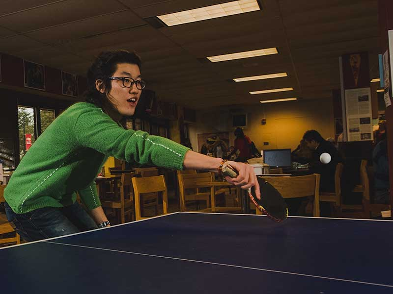 ESL student playing ping-pong in the Eagle's Nest