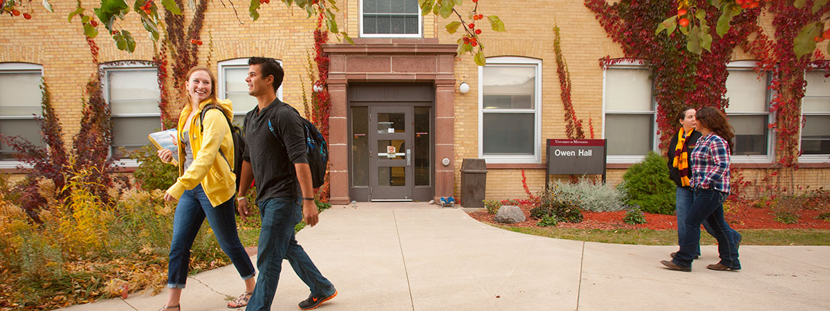 Students walking in front of Owen Hall during the fall.