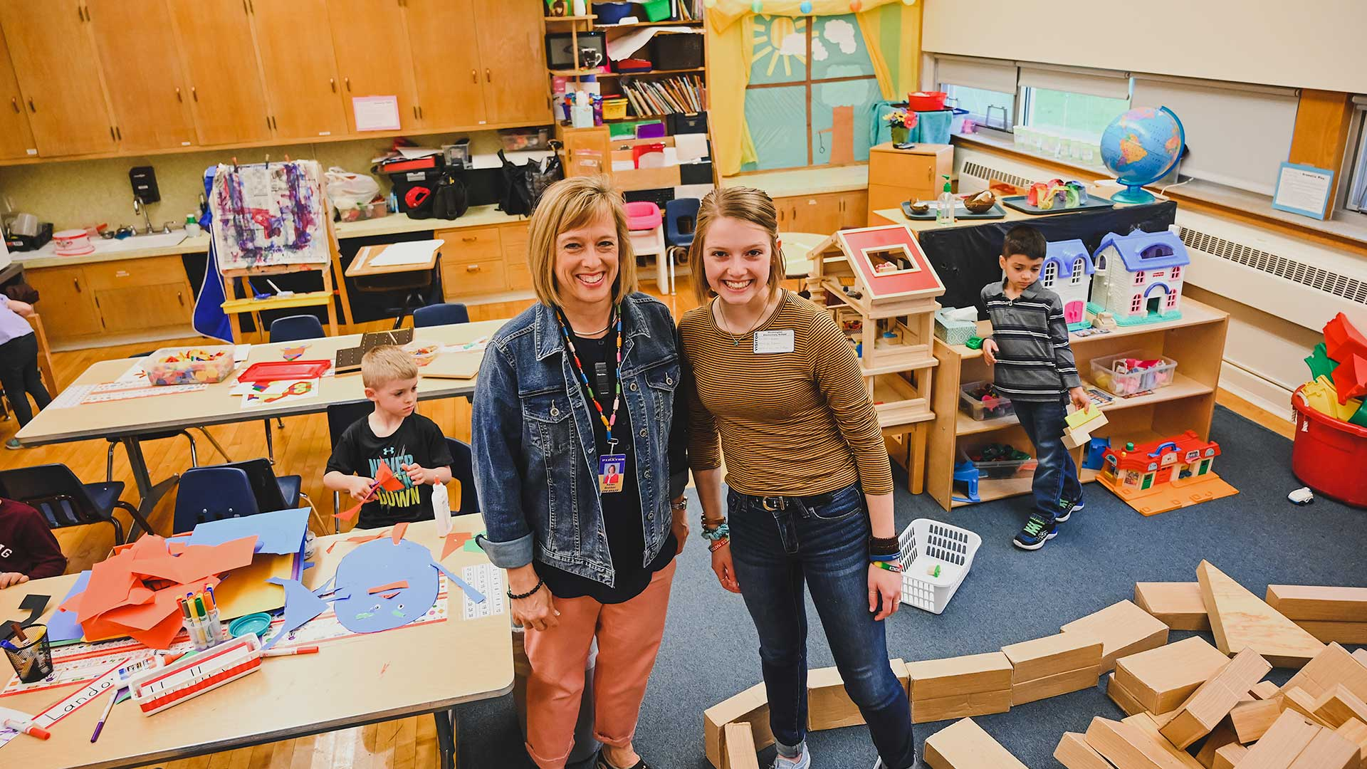 Karen and Karlie Brekken in an elementary classroom