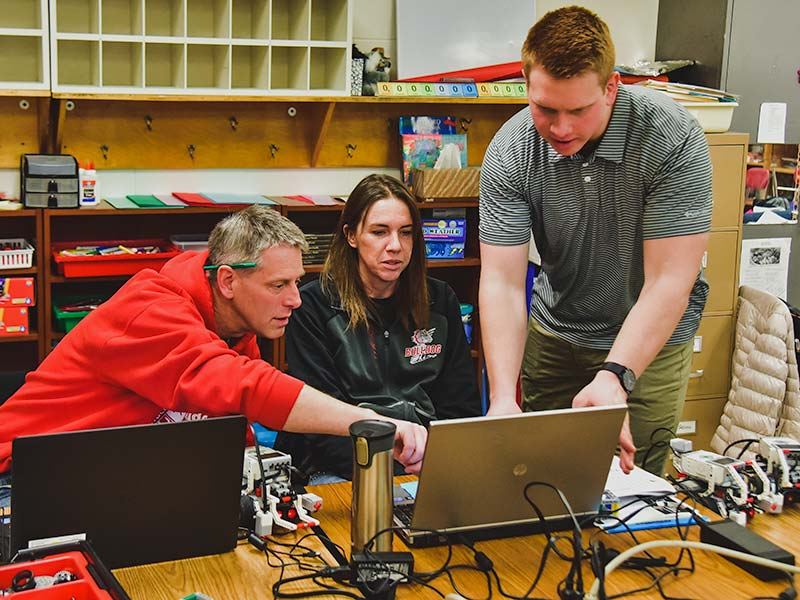 Josh Kauck working with High School Teachers on a robotics