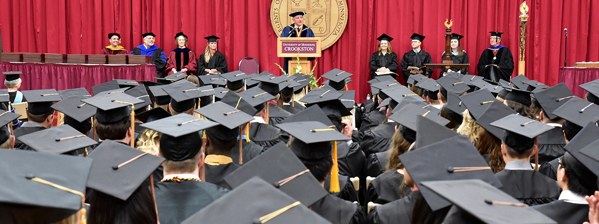Commencement ceremony with former Chancellor Wood speaking.