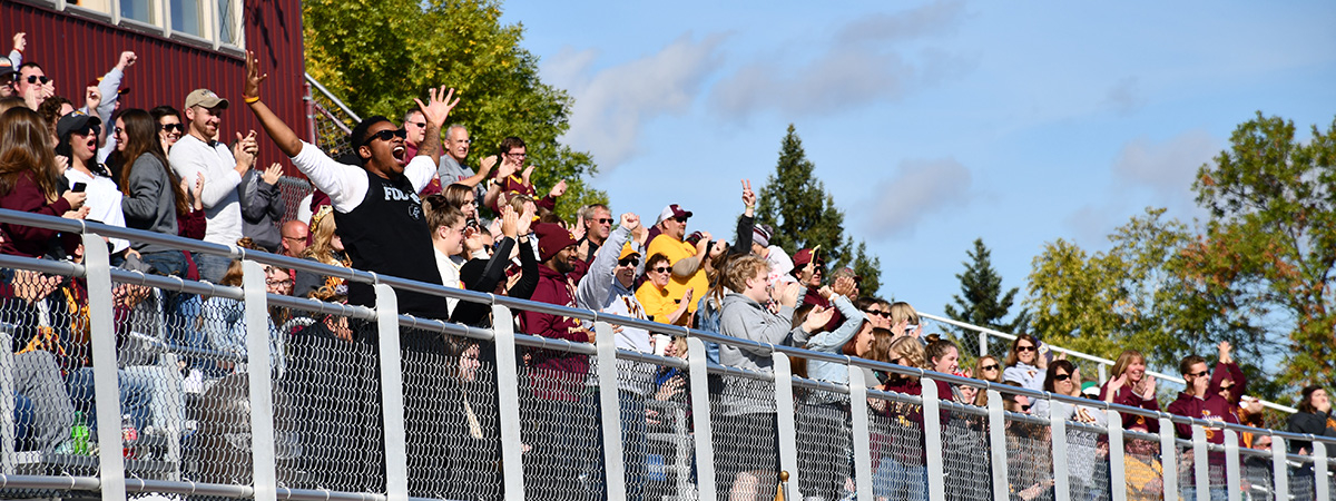 Fans at the Homecoming 2019 game screaming and cheering