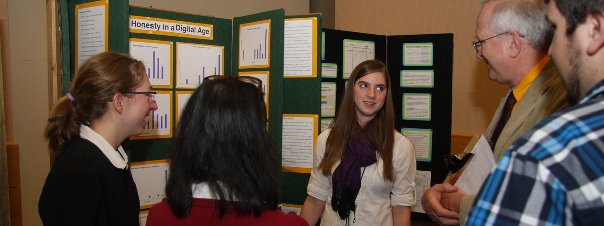 Students poster presentation with judges.