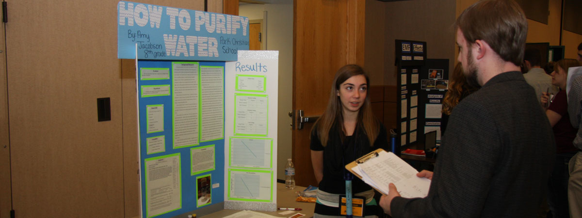 Student poster presentation on water purification.
