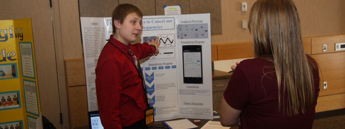 Student presenting his findings on electricity.